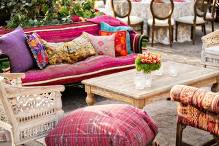outdoor-wedding-reception-lounge-boho-chic-wood-furniture-pink-purple-floor-pillow-furnishings-decor