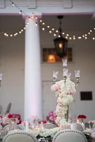 wedding-reception-candelabra-covered-with-white-hydrangeas-and-pink-florals