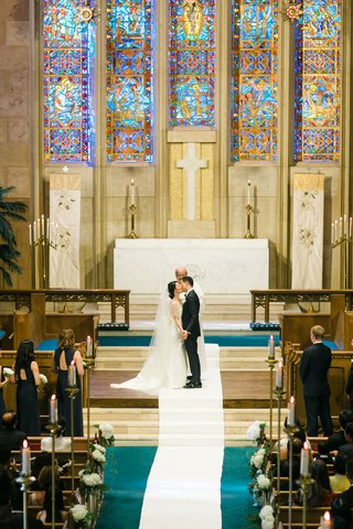 bride-in-pretty-wedding-dress-with-special-ceremony-top-and-groom-kiss-at-altar-westwood-church-la