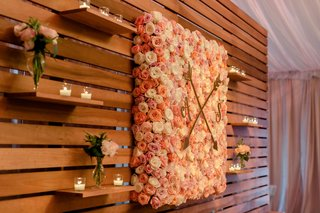 wedding-reception-wood-planks-floating-shelves-flower-wall-with-monogram-and-crest