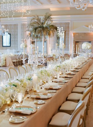 wedding-reception-long-table-beige-linen-white-flower-runner-crystal-candelabra-white-wood-chairs