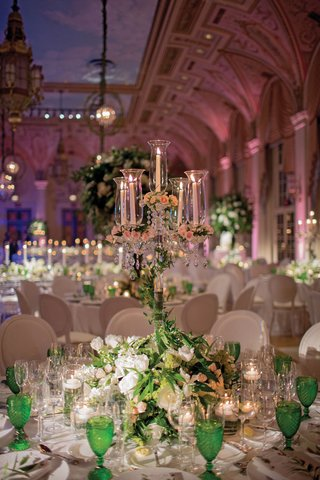 candelabra-with-tapered-candles-candelabra-wrapped-in-greenery-blush-blossoms