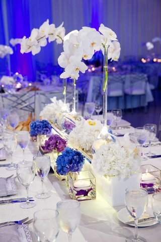 white-orchid-in-bulb-vase-with-floating-candles-at-reception