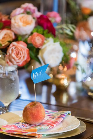 wedding-reception-wood-table-colorful-napkin-fresh-peach-fruit-with-flag-place-card