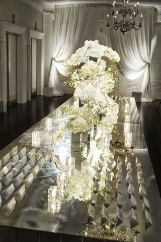 white-floral-arrangements-on-mirror-tabletop