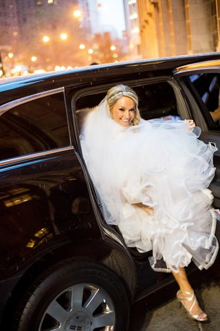 bride-in-monique-lhuillier-ball-gown-exits-limo-while-holding-skirt