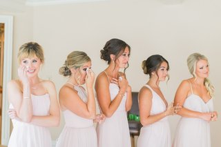 bridesmaids-in-pale-blush-tear-up-at-sight-of-bride-bridesmaids-in-blush-jim-hjlem