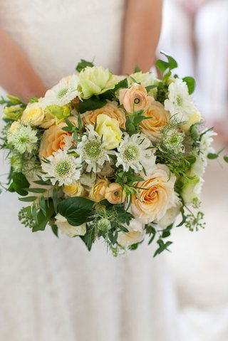 wedding-bouquet-with-white-flowers-light-orange-roses-yellow-blooms-and-greenery-colorful