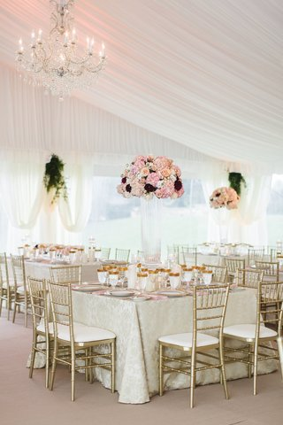 wedding-reception-square-table-ivory-linen-gold-chair-gold-glassware-tall-pink-flowers-glass-vase