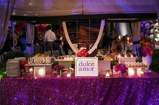 purple-tablecloth-on-dessert-table-with-mini-desserts-and-cake-pops