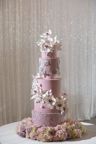 purple-wedding-cake-with-silver-details-decorations-and-cascading-white-purple-sugar-flowers