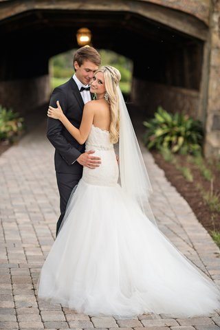bride-in-white-strapless-dress-with-groom-in-tuxedo