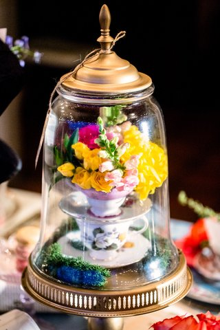 alice-in-wonderland-wedding-shoot-stack-of-teacups-with-bright-flowers-under-glass-dome