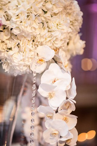 white-flower-arrangement-at-reception-with-orchid-and-crystal-strands