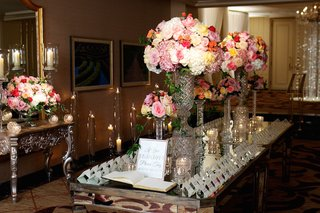 seating-cards-and-crystal-vases-on-mirror-tabletop