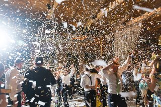 confetti-falls-over-dancing-guests-at-wedding-reception