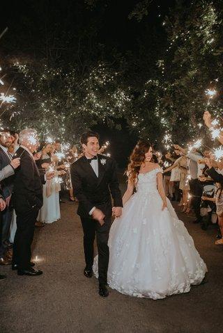 echosmith-singer-sydney-sierota-and-cameron-quiseng-wedding-reception-outdoor-grand-exit-sparklers