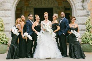 bride-in-hayley-paige-bridesmaids-in-black-lazaro-and-amsale-bridesmen-in-ike-behar