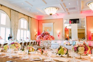 ballroom-reception-crystal-candelabra-topped-with-pink-roses-and-lower-arrangements-on-long-tables