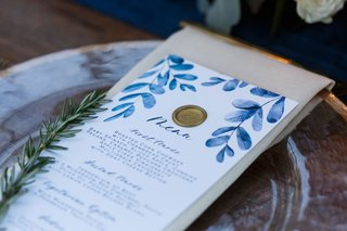white-and-blue-watercolor-design-motif-menu-card-calligraphy-gold-wax-seal-sprig-of-rosemary-herbs