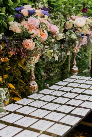 wedding-reception-outdoor-escort-card-table-mirror-with-gold-vase-rose-purple-flowers-pink-burgundy