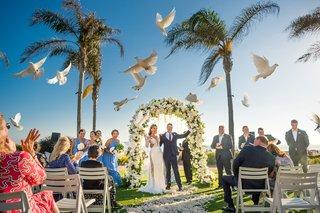 doves-being-released-ceremony-outside-animals-hotel-del-coronado-california-wedding-bride-groom-bird