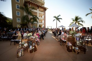 mexico-wedding-with-family-photos-on-wood-crates-at-entrance