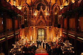 wedding-ceremony-at-angel-orensanz-foundation-for-the-arts-with-golden-lighting