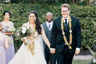 bride-in-long-sleeve-wedding-dress-sheer-braid-in-hair-groom-hindu-and-christian-customs