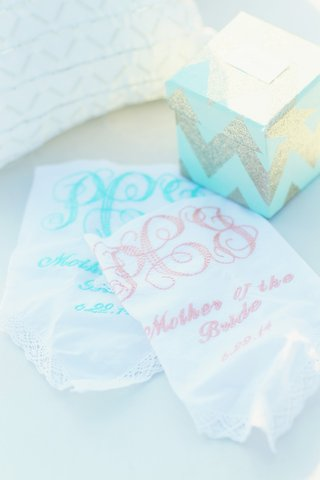 white-handkerchief-with-monogram-and-date-embroidered-in-pink-and-light-blue