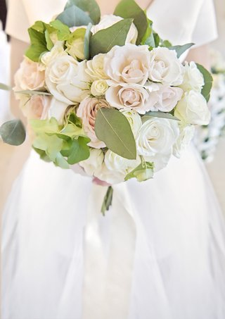 bridal-bouquet-with-ivory-and-blush-roses-and-large-eucalyptus-leaves