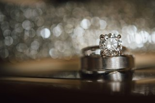 wedding-ring-round-diamond-solitaire-engagement-ring-on-mens-wedding-band-brushed