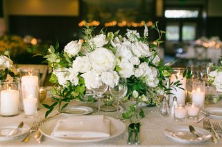 wedding-reception-white-rose-and-garden-rose-centerpiece-short-with-candles-pillar-votive-linens