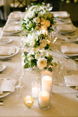 wedding-reception-long-table-white-rose-flower-centerpiece-greenery-candles