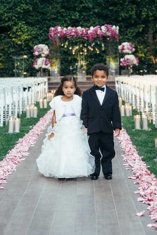 african-american-flower-girl-in-ruffle-dress-and-ring-bearer-in-tuxedo-with-bow-tie