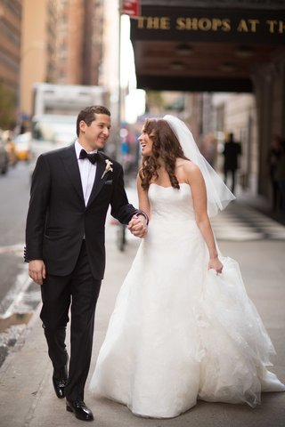 bride-in-vera-wang-wedding-dress-and-groom-in-tuxedo-bow-tie-at-the-plaza-hotel-in-new-york-city