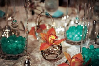 tiffany-blue-crystals-inside-glass-vase-wedding-centerpiece
