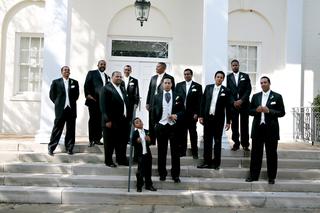 ring-bearer-groom-and-groomsmen-in-front-of-church