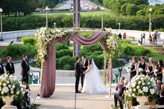 bride-and-groom-under-chuppah-mauve-drapery-greenery-birch-post-jewish-traditions-secular-ceremony