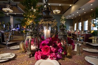 lantern-and-rose-centerpieces-gold-table-number-indoor-forest-theme-wedding-reception