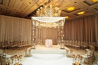 white-and-gold-detailed-chuppah-at-jewish-and-christian-wedding-ceremony