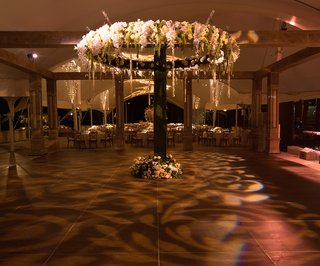 lace-lighting-pattern-on-dance-floor-at-rustic-tent-wedding