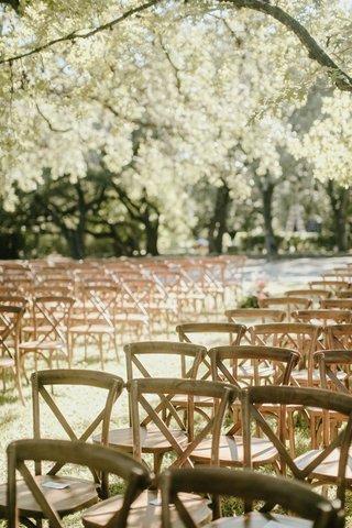 romantic-wedding-setting-outdoor-venue-austin-texas-wood-vineyard-chair-x-back-style-trees