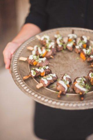 zaatar-spiced-lamb-sirloin-red-onion-bell-pepper-skewer-lemon-tahini-sauce-on-wood-tray-wedding