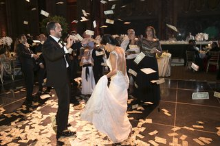 bride-in-a-inbal-dror-wedding-gown-with-sparkly-straps-dances-with-greek-groom-in-black-tuxedo
