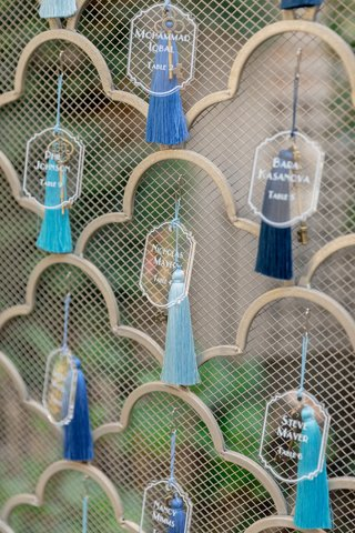 lucite-escort-cards-attached-to-tassels-in-different-shades-of-blue