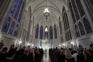 wedding-ceremony-at-cathedral-sanctuary-church-in-chicago-stained-glass-windows-chandelier-lighting