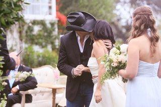 father-of-the-bride-in-black-cowboy-hat-bride-in-monique-lhuillier-crop-top-wedding-dress