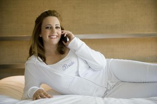 bride-on-cell-phone-in-white-tracksuit-and-tank