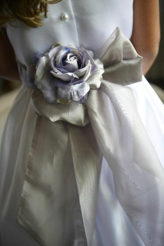 purple-and-silver-fabric-flower-on-back-of-flower-girl-dress